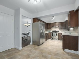 """Photo 11: 916 MERRITT Street in Coquitlam: Harbour Chines House for sale in """"HARBOUR CHINES"""" : MLS®# R2305133"""