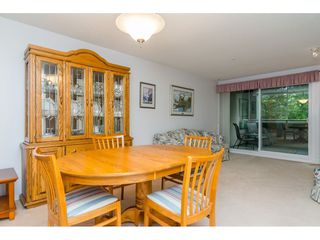 "Photo 3: 322 13880 70 Avenue in Surrey: East Newton Condo for sale in ""Chelsea Gardens"" : MLS®# R2348345"