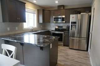 Photo 2: 57 12815 Cumberland Road in Edmonton: Zone 27 Townhouse for sale : MLS®# E4154744