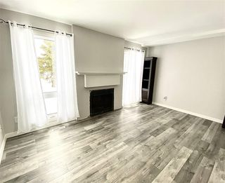 Photo 2: 1032 LAKEWOOD Road N in Edmonton: Zone 29 Townhouse for sale : MLS®# E4188450