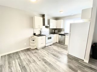 Photo 4: 1032 LAKEWOOD Road N in Edmonton: Zone 29 Townhouse for sale : MLS®# E4188450