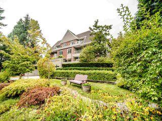 """Photo 1: 311 2020 CEDAR VILLAGE Crescent in North Vancouver: Westlynn Condo for sale in """"KIRKSTONE GARDENS"""" : MLS®# R2499573"""