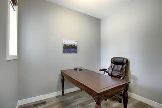 Photo 4: 436 DISCOVERY Place SW in Calgary: Discovery Ridge Detached for sale : MLS®# A1035589