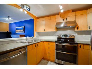 """Photo 2: 41 7488 SOUTHWYNDE Avenue in Burnaby: South Slope Townhouse for sale in """"LEDGESTONE 1"""" (Burnaby South)  : MLS®# V1110457"""