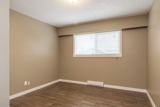 Photo 10: 10125 131 Street in Surrey: Cedar Hills Fourplex for sale (North Surrey)  : MLS®# R2122873