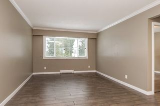 Photo 2: 10125 131 Street in Surrey: Cedar Hills Fourplex for sale (North Surrey)  : MLS®# R2122873