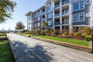 "Photo 1: 113 4500 WESTWATER Drive in Richmond: Steveston South Condo for sale in ""COPPER SKY WEST"" : MLS®# R2218071"