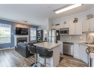 """Photo 4: 105 33502 GEORGE FERGUSON Way in Abbotsford: Central Abbotsford Condo for sale in """"CARINA COURT"""" : MLS®# R2250786"""