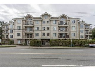 """Photo 1: 105 33502 GEORGE FERGUSON Way in Abbotsford: Central Abbotsford Condo for sale in """"CARINA COURT"""" : MLS®# R2250786"""