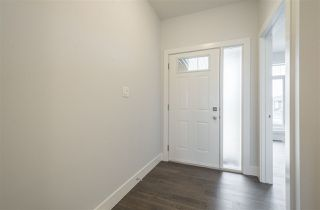 Photo 2: 15 4517 190A Street in Edmonton: Zone 20 Townhouse for sale : MLS®# E4139574