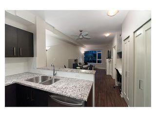 "Photo 1: 102 6611 ECKERSLEY Road in Richmond: Brighouse Condo for sale in ""MODENA"" : MLS®# V888833"