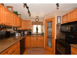 Photo 4: 54 WEST EDGE Road: Cochrane Residential Detached Single Family for sale : MLS®# C3618257