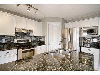 Photo 7: 544 COUGAR RIDGE Drive SW in Calgary: Cougar Ridge House for sale : MLS®# C4003202