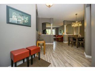 "Photo 3: 424 13880 70TH Avenue in Surrey: East Newton Condo for sale in ""CHELSEA GARDENS"" : MLS®# F1445932"