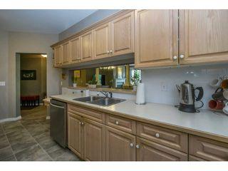 "Photo 5: 424 13880 70TH Avenue in Surrey: East Newton Condo for sale in ""CHELSEA GARDENS"" : MLS®# F1445932"