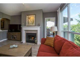 "Photo 9: 424 13880 70TH Avenue in Surrey: East Newton Condo for sale in ""CHELSEA GARDENS"" : MLS®# F1445932"