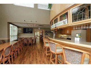 "Photo 19: 424 13880 70TH Avenue in Surrey: East Newton Condo for sale in ""CHELSEA GARDENS"" : MLS®# F1445932"