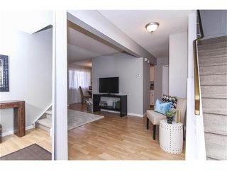 Photo 4: 1 6424 4 Street NE in Calgary: Thorncliffe House for sale : MLS®# C4035130