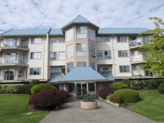 "Photo 1: 101 7685 AMBER Drive in Sardis: Sardis West Vedder Rd Condo for sale in ""The Sapphire"" : MLS®# R2372099"