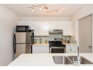 "Photo 3: 702 1750 MCKENZIE Road in Abbotsford: Poplar Townhouse for sale in ""Alderglen"" : MLS®# R2508035"