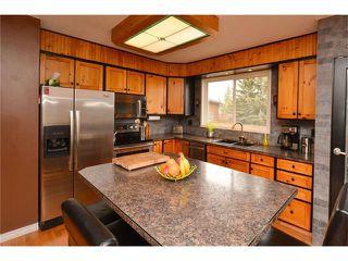 Photo 7: 34 GLENPATRICK Place: Cochrane House for sale : MLS®# C4055156