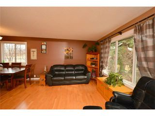 Photo 4: 34 GLENPATRICK Place: Cochrane House for sale : MLS®# C4055156