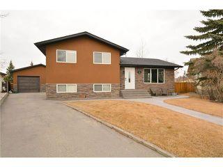 Photo 1: 34 GLENPATRICK Place: Cochrane House for sale : MLS®# C4055156