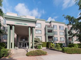 "Photo 1: 220 13880 70 Avenue in Surrey: East Newton Condo for sale in ""Chelsea Gardens"" : MLS®# R2288215"