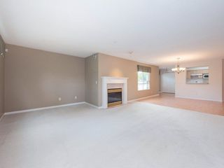 "Photo 4: 220 13880 70 Avenue in Surrey: East Newton Condo for sale in ""Chelsea Gardens"" : MLS®# R2288215"