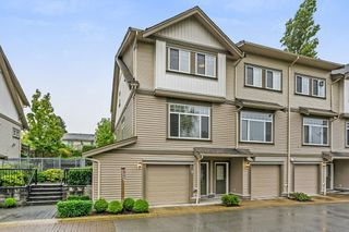 "Photo 1: 8 13393 BARKER Street in Surrey: Queen Mary Park Surrey Townhouse for sale in ""Grand Lane"" : MLS®# R2311347"