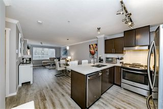 "Photo 4: 202 700 KLAHANIE Drive in Port Moody: Port Moody Centre Condo for sale in ""BOARDWALK"" : MLS®# R2345334"