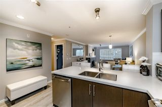 "Photo 3: 202 700 KLAHANIE Drive in Port Moody: Port Moody Centre Condo for sale in ""BOARDWALK"" : MLS®# R2345334"