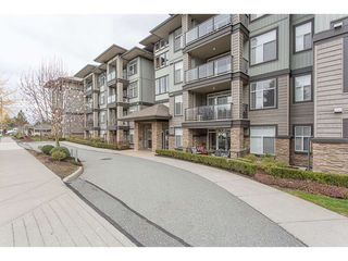 "Photo 1: 106 2068 SANDALWOOD Crescent in Abbotsford: Central Abbotsford Condo for sale in ""The Sterling"" : MLS®# R2368477"
