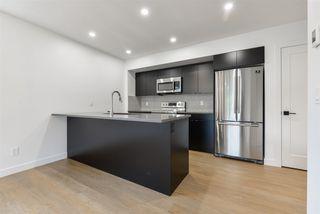 Photo 1: 1 11306 92 Street in Edmonton: Zone 05 House Half Duplex for sale : MLS®# E4204209