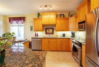 Photo 17: 18 DISCOVERY WOODS Villa SW in Calgary: Discovery Ridge Row/Townhouse for sale : MLS®# A1015288