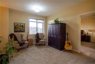 Photo 8: 18 DISCOVERY WOODS Villa SW in Calgary: Discovery Ridge Row/Townhouse for sale : MLS®# A1015288