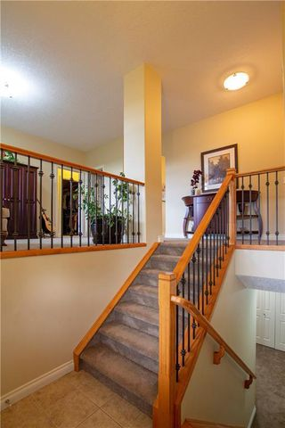 Photo 5: 18 DISCOVERY WOODS Villa SW in Calgary: Discovery Ridge Row/Townhouse for sale : MLS®# A1015288