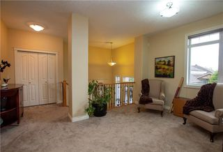 Photo 7: 18 DISCOVERY WOODS Villa SW in Calgary: Discovery Ridge Row/Townhouse for sale : MLS®# A1015288