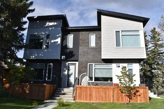 Main Photo: 1806 44 Street NW in Calgary: Montgomery Row/Townhouse for sale : MLS®# A1030073