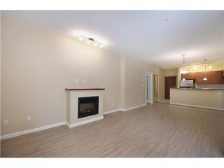 Photo 5: 315 100 CAPILANO Road in Port Moody: Port Moody Centre Condo for sale : MLS®# V985603