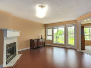 """Photo 2: 203 17740 58A Avenue in Surrey: Cloverdale BC Condo for sale in """"DERBY DOWNS"""" (Cloverdale)  : MLS®# F1442364"""