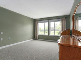 """Photo 9: 203 17740 58A Avenue in Surrey: Cloverdale BC Condo for sale in """"DERBY DOWNS"""" (Cloverdale)  : MLS®# F1442364"""