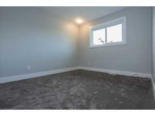 Photo 12: 33512 KINSALE Place in Abbotsford: Poplar House for sale : MLS®# R2059562