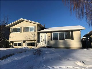Photo 1: 244 QUEEN CHARLOTTE Way SE in Calgary: Queensland House for sale : MLS®# C4096848