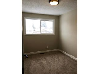 Photo 15: 244 QUEEN CHARLOTTE Way SE in Calgary: Queensland House for sale : MLS®# C4096848