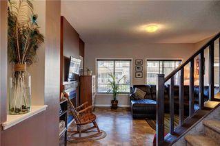Photo 11: 312 CIMARRON VISTA Way: Okotoks House for sale : MLS®# C4131376