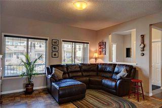 Photo 12: 312 CIMARRON VISTA Way: Okotoks House for sale : MLS®# C4131376