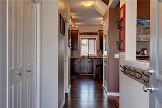 Photo 8: 312 CIMARRON VISTA Way: Okotoks House for sale : MLS®# C4131376