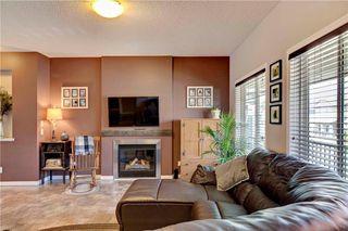Photo 10: 312 CIMARRON VISTA Way: Okotoks House for sale : MLS®# C4131376