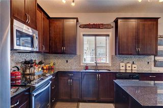 Photo 16: 312 CIMARRON VISTA Way: Okotoks House for sale : MLS®# C4131376